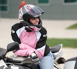 This is an image of a woman on a motorcycle.